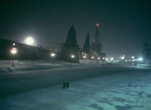 Red Star Atop Kremlin Tower Glowing Against Night-Dim Sky in Snow-Covered, Wintry Moscow, Ussr by Carl Mydans