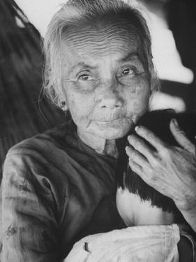 South Vietnamese Refugee Holding Small Child by Carl Mydans