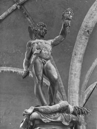 Young Perseus Holding the Decapitated Gorgon Head of Medusa, Standing over Her Body by Carl Mydans