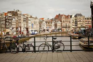 A Bridge over a Canal in Amsterdam, Netherlands by Carlo Acenas