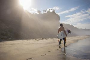 A Surfer at Black's Beach Near from the Torrey Pines State Reserve in San Diego, California by Carlo Acenas