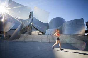 A Young Woman Runs at the Walt Disney Concert Hall in Downtown Los Angeles, California by Carlo Acenas