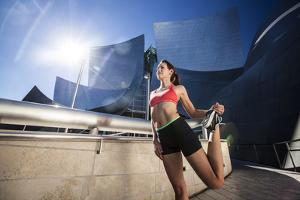 A Young Woman Stretches at the Walt Disney Concert Hall in Downtown Los Angeles, California by Carlo Acenas