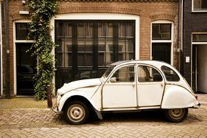 Vintage Citroen on a Street in Amsterdam, Netherlands by Carlo Acenas
