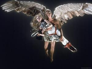 "Actress Jane Fonda Being Carried by Guardian Angel in a Scene from Roger Vadim's Film ""Barbarella"" by Carlo Bavagnoli"