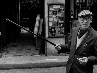 American Author Henry Miller Walking Along the Street