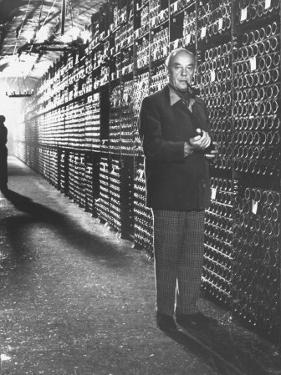 Baron Philippe De Rothschild in a Wine Cellar at Chateau Mouton Rothschild by Carlo Bavagnoli