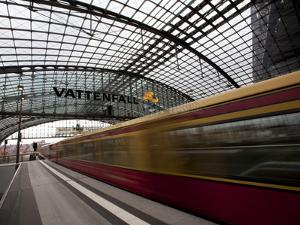 Train Leaving Berlin Hauptbahnhof, the Main Railway Station in Berlin, Germany, Europe by Carlo Morucchio