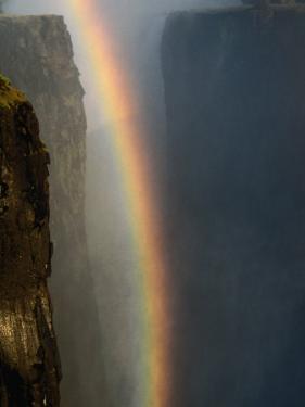 Rainbow Over Cliffs, Victoria Falls, Zambia by Carol Polich