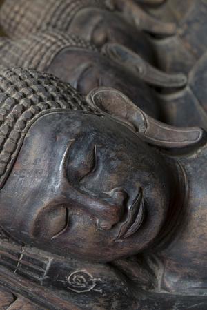https://imgc.allpostersimages.com/img/posters/carved-buddha-heads-phnom-penh-cambodia-southeast-asia_u-L-Q12SAIU0.jpg?artPerspective=n