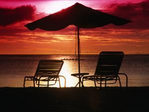 Sunset Over Beach, Palau by Casey Mahaney