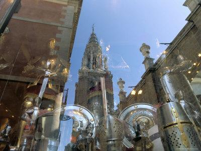 https://imgc.allpostersimages.com/img/posters/cathedral-reflected-in-window-of-shop-selling-medieval-armour-toledo-castilla-la-mancha-spain_u-L-P1TI0L0.jpg?p=0