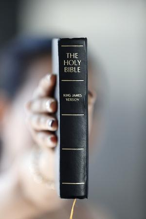 https://imgc.allpostersimages.com/img/posters/catholic-woman-with-the-holy-bible-in-hands_u-L-Q1GYMOI0.jpg?artPerspective=n