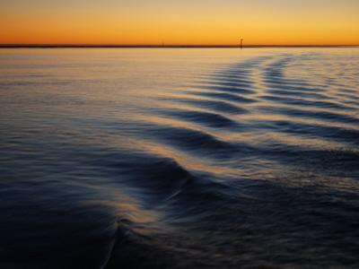 Ripple Lines of Boat in Water in Karumba Shipping Channel at Sunset