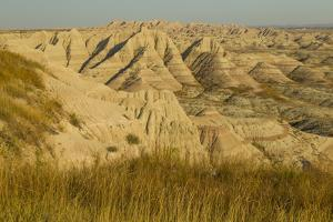 USA, South Dakota, Badlands NP. Grass and Eroded Formations by Cathy & Gordon Illg