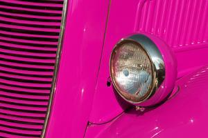 Closeup Detail of the Headlight of an Antique Car Painted Pink by ccaetano