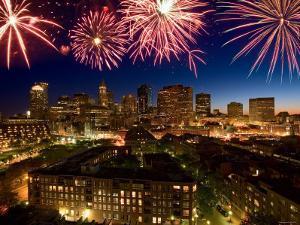 Celebration with Exploding Fireworks over Skyline of Boston, Massachusetts