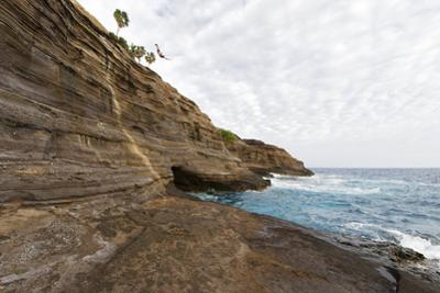 Athlete Dives from Rock into Ocean