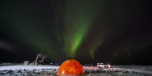 Aurora Borealis in the Sky Above a Planetarium in Iceland by Chad Copeland