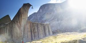 Climber at the Top of Route with Belayer Below in the Cirque of the Unclimbables by Chad Copeland