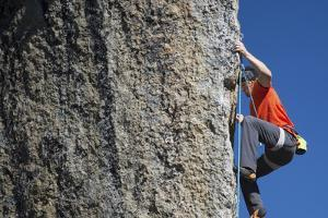 Male Climber Ascending Rock at Cirque of the Unclimbables by Chad Copeland