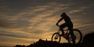 Silhouette of a Mountain Biker at Sunset by Chad Copeland