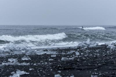 Surfer Finds a Wave at Jokulsarlon, South Iceland by Chad Copeland