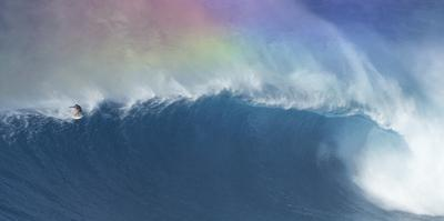 Surfer Riding a Maverick Wave on the North Shore of Maui by Chad Copeland