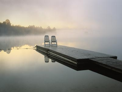 https://imgc.allpostersimages.com/img/posters/chairs-on-dock-algonquin-provincial-park-ontario-canada_u-L-P246OI0.jpg?p=0