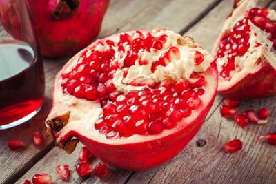 Pieces of Ripe Pomegranate and Juice in Glass by ChamilleWhite