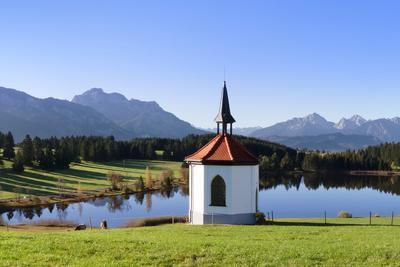 https://imgc.allpostersimages.com/img/posters/chapel-at-hergratsrieder-see-lake-with-allgau-alps_u-L-PNGEKS0.jpg?p=0