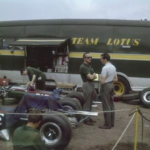 Chapman and Clark Outside the Lotus Team Bus, French Grand Prix, Clermont-Ferrand, France, 1965