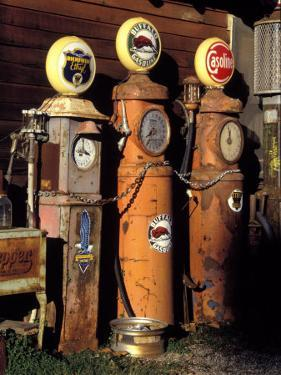 Three Old Gas Pumps by Charles Benes