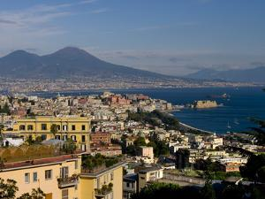 Cityscape and Mount Vesuvius, Naples, Campania, Italy, Europe by Charles Bowman