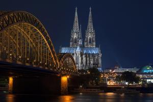 Cologne Cathedral, UNESCO World Heritage Site, and Hohenzollern Bridge at Dusk by Charles Bowman
