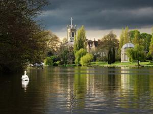 Hampton Church is seen across moody river Thames by Charles Bowman