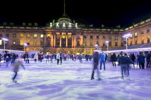 Ice skating, Somerset House, London, England, United Kingdom, Europe by Charles Bowman