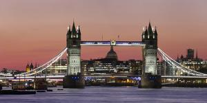 Panoramic view of Tower Bridge framing St. Paul's Cathedral at dusk, London, England by Charles Bowman