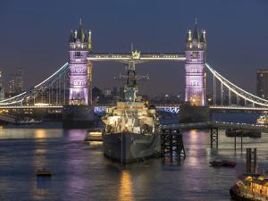 Tower Bridge and HMS Belfast on the River Thames at dusk, London, England, United Kingdom, Europe by Charles Bowman