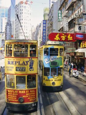 Trams in Wan Chai (Wanchai), Hong Kong, China by Charles Bowman