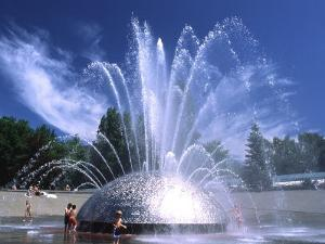 Children Play in the International Fountain of Seattle Center, Seattle, Washington, USA by Charles Crust