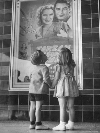 Children Looking at Posters Outside Movie Theater by Charles E. Steinheimer