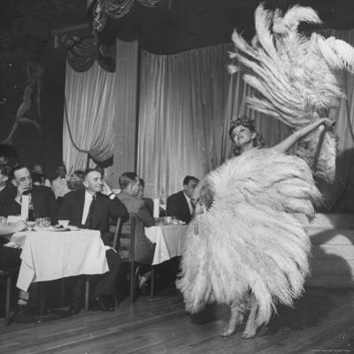 Customers at Sally Rand's Nightclub Watching a Dancer Performing the Midnight Fan Dance by Charles E. Steinheimer