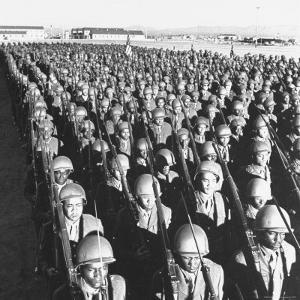 First All Black Combat Division, 93Rd, on Parade after Hike in Sweltering Heat at Fort Huachuca by Charles E. Steinheimer