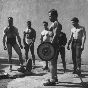 Prisoners at San Quentin Weightlifting in Prison Yard During Recreation Period by Charles E. Steinheimer