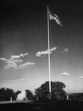 Soldiers Lowering American Flag by Charles E. Steinheimer