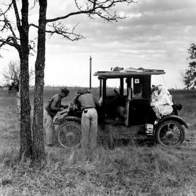 Three Men Working on 1918 Ford Model T - Has Bundles in Back and Can of Prestone on Running Board by Charles E. Steinheimer