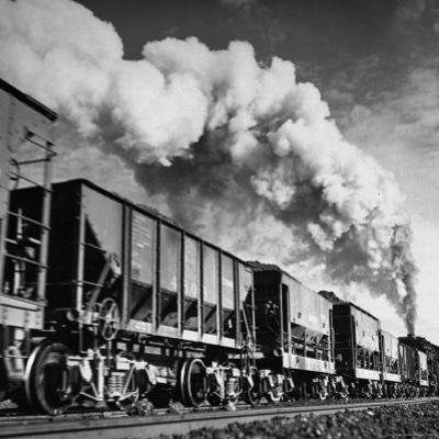 View of a Railcar Loaded with Iron Ore Moving Along the Tracks by Charles E. Steinheimer