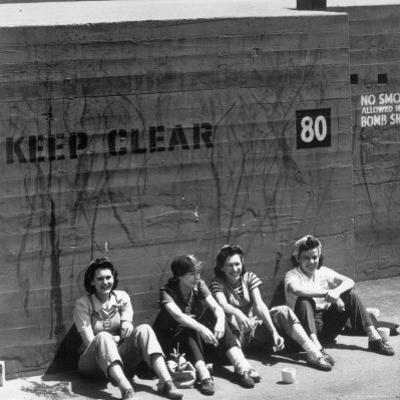 Workers Sitting Against Wall During Lunch Break, at Vega Aircraft Plant, During WWII: Burbank, Ca