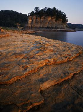 Eroded limestone and Tower Rock, Mississippi River, Perry County, Missouri, USA by Charles Gurche